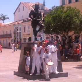 The kids of Grupo Nzinga posing in front of Zumbi