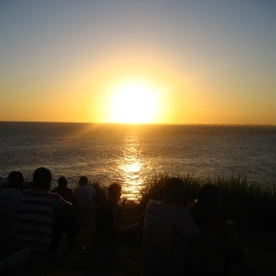 Watching the sunset with the crowd, applauding as it disappears